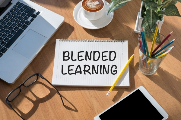 BLENDED LEARNING open book on table and coffee Business